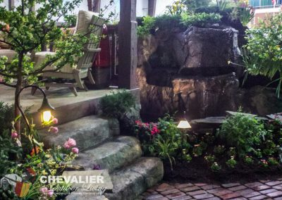 Carved and Colored Concrete Water Feature & Steps with Reclaimed Brick Pathway