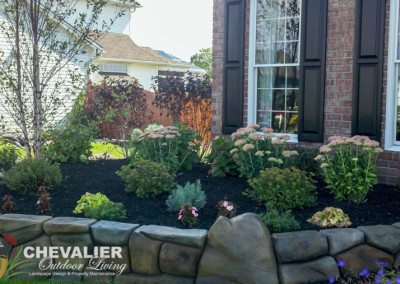 Custom Carved & Colored Concrete Wall with Newly Planted Foundational & Perennial Plantings