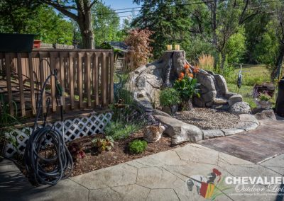 Carved Concrete Water Feature and Stamped Patio