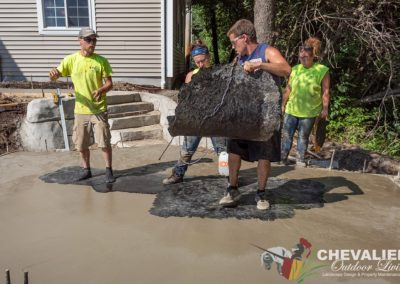 Workers Stamping Concrete Patio