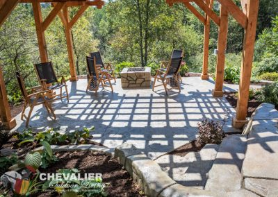 Hillside Patio with Concrete Patio, Post & Beam Structure & Concrete Fire Pit
