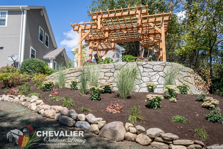 Hillside Patio, Concrete Retaining Wall, Post and Beam Structure and Perennial Gardens