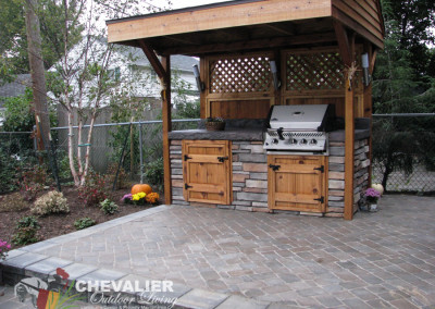 Outdoor Grilling Cabana Atop a Concrete Pavers Patio