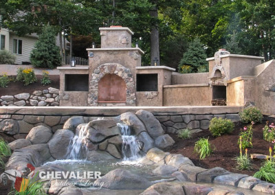 Natural Stone & Stucco Fireplace, Oven and Carved & Colored Concrete Water Feature