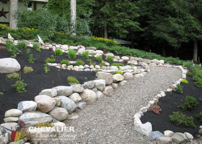 Natural Boulder Wall and Gravel Walkway