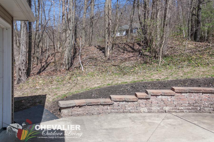 Before: Brick Wall and Driveway