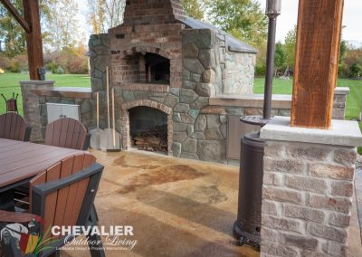 Carved Concrete and Brick Oven and Outdoor Kitchen with Added Brick Column